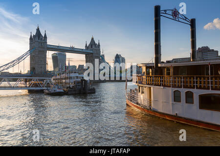 Tower Bridge, traditional riverboat and City of London skyline from Butler's Wharf, London, England, United Kingdom, Europe - Stock Image