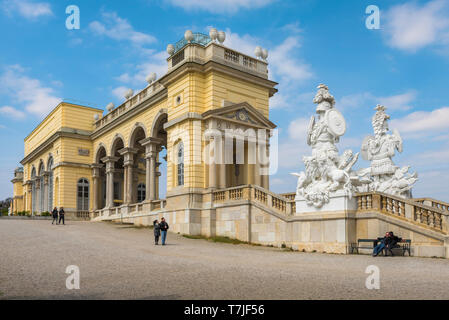 Schloss Schonbrunn, view of the south east entrance to the Gloriette with huge baroque statues sited on its staircase, Schloss Schönbrunn, Vienna. - Stock Image