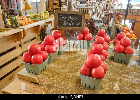 Farm fresh beefsteak tomatoes on display for sale in a rural Alabama farmer's market or roadside market in Pike Road Alabama, USA. - Stock Image