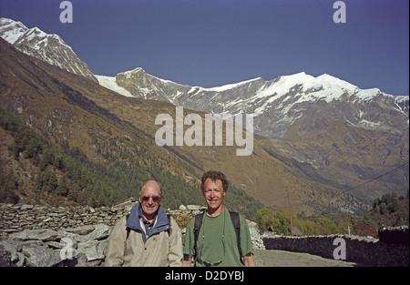 David Keith Jones and son Mark south of Kalopani in Kali Gandaki world's deepest valley on Annapurna circuit Himalayas - Stock Image