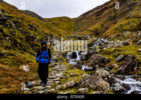 Cumbria, UK. 7th December, 2018. UK Weather: A walker braves the weather today near Borrowdale, Cumbria, UK. Credit: © JHNews / Alamy Live News - Stock Image
