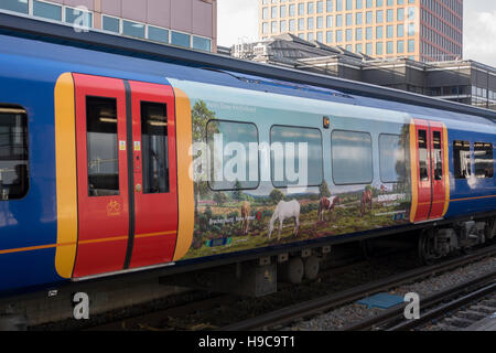 South West Trains EMU with Martin Davey Art -1 - Stock Image