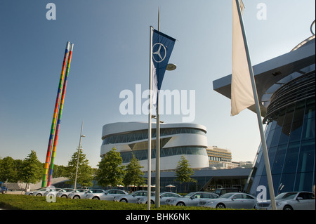 image of mercedes benz museum exterior with car line up - Stock Image