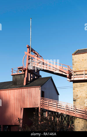 The wooden colliery heapstead or pit head with winding wheels at Beamish Museum, north east England, UK - Stock Image