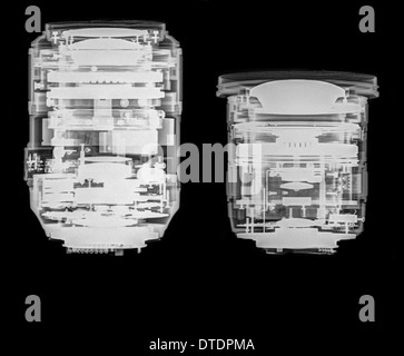 Camera lens under x-ray. the optical elements can be seen. Nikkor 105mm Micro (left) Sigma 10-20mm zoom (right) - Stock Image