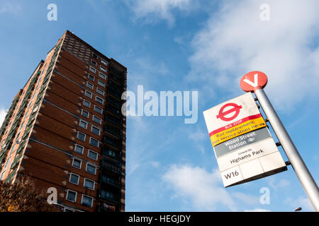 Bus Stop V at Wood Steet Station in Waltham Forest, East London, with rail replacement bus service sign, and tower - Stock Image