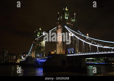 London Bridge, London, UK, Night Scene with Lights on the River Thames, taken whilst walking about London in a street - Stock Image