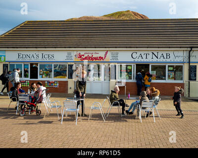 A busy beach café at Cat Nab Saltburn by the Sea North Yorkshire with Ednas Ices and a fish bar - Stock Image