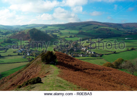 View from Hergest Ridge, the hill which traverses the border between Herefordshire and Powys. The village of Gladestry visible at the foothill. Wales. - Stock Image