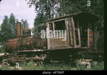 Old locomotive with plow front; Railroad Museum, Dawson, Yukon Territory, Canada. - Stock Image