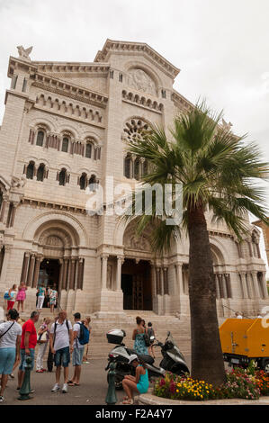 Monaco Cathedral with tourists next to the palm tree, Monaco, France - Stock Image
