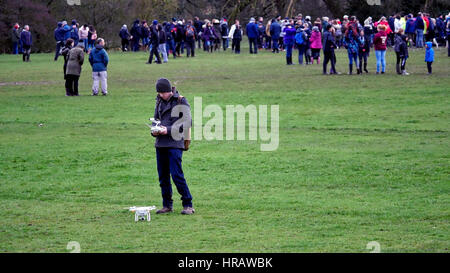 Ashbourne, UK. 28th Feb, 2017. A drone pilot lands his DJI drone after flying over the crowd during the Ashbourne - Stock Image