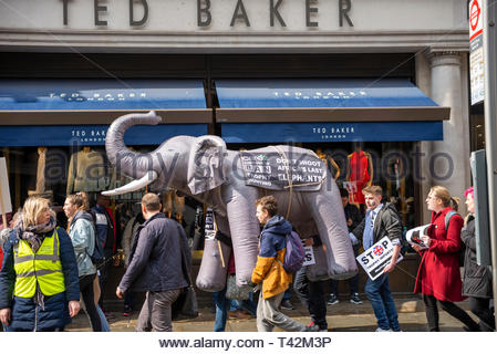 London, UK. 13th April 2019. A protest march is taking place in London demonstrating against the threat of extinction of wildlife and highlighting the act of trophy hunting in particular of elephants and rhinos. It is part of the 5th global march for elephants and rhinos and is timed to take place before a conference in Sri Lanka calling to uplist elephants to Appendix I (highest level of protection) and to reject proposals to allow the ivory trade of the Southern White Rhino. Protesters gathered in Cavendish Square and marched to Whitehall. Credit: Avpics / Alamy Live News - Stock Image