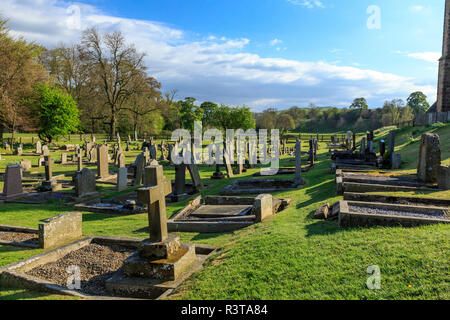 England, North Yorkshire, Wharfedale, Bolton Abbey, Bolton Priory. Grounds and ruins of 12th century Augustinian monastery. Near River Wharfe. Graves. - Stock Image