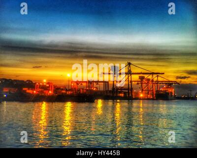 View Of Suspension Bridge Over Sea Against Sky During Sunset - Stock Image
