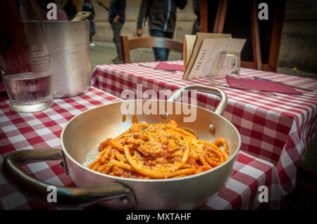 Delicious plate of pasta with Amatriciana sauce in Trastevere, Rome, italy - Stock Image