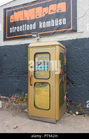 Berlin, gold telephone booth is world's smallest disco, RAW district - Stock Image