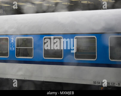 view of a train through a window in a rainy day, Czech Republic - Stock Image