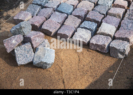 cobblestone paving - granite stone pavers on the gravel - Stock Image
