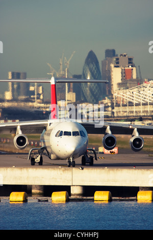 Regional airliner at London City Airport, England, UK - Stock Image