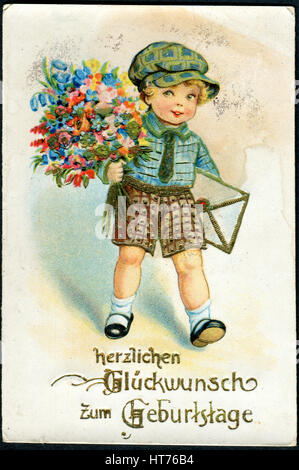 GERMANY - CIRCA 1935: A greeting postcard printed in Germany, shows a boy with flowers. The inscription in German: - Stock Image