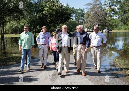U.S President Donald Trump, center, walks with South Carolina Governor Henry McMaster, right, during a visit to view flooding caused by Hurricane Florence September 19, 2018 in Conway, South Carolina. Florence dumped record amounts of rainfall along the North & South Carolina coast causing widespread flooding. - Stock Image