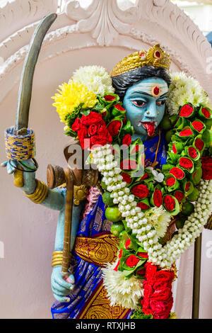 Goddess Kali in the Hindu Sri Maha Muneswarar Temple, Kuala Lumpur, Malaysia. - Stock Image