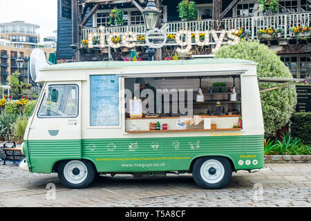 A Rice Guys food van in St Katherine Katherines Dock in Wapping in London. - Stock Image