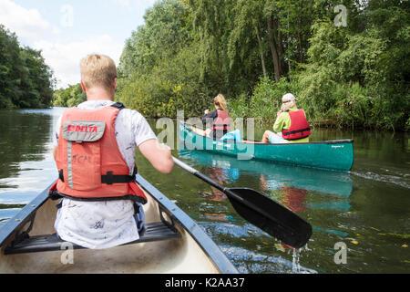 Canoeing on the Norfolk Broads near Wroxham, UK. - Stock Image