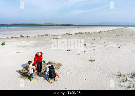 Narin, County Donegal, Ireland. 19th April 2019. People enjoy the fine weather on Narin Strand, part of the 'Wild Atlantic Way', on what is the hottest day of the year, so far, on the north-west coast. Credit: Richard Wayman/Alamy Live News - Stock Image