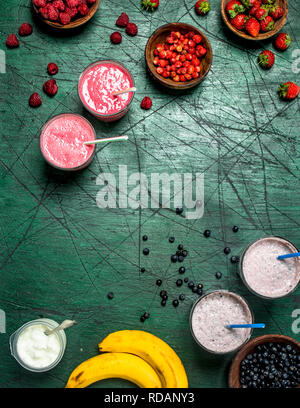 Berry smoothie with a banana. On rustic background. - Stock Image