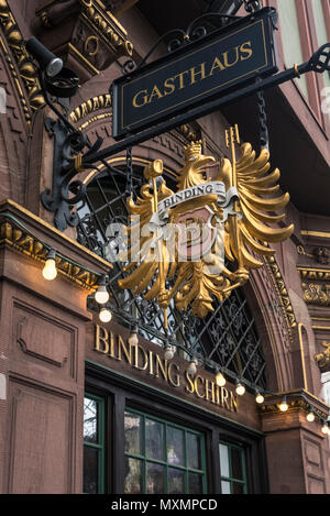 Ornate decoration and sign on the Binding-Schirn Gasthaus located in the historic old town (Altstadt) district of Frankfurt am Main, Hesse, Germany - Stock Image