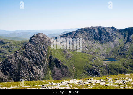 View to Mount Tryfan peak Llyn Bochlwyd and Glyder Fach from Pen yr Ole Wen in mountains of Snowdonia National Park. - Stock Image
