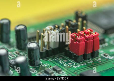 Macro-photo  of printed circuit board (PCB) with set of 'jumpers' - Stock Image