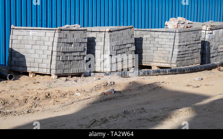 paving slabs packed in the stack prepared for laying outdoor closeup - Stock Image