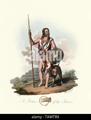 Ancient Briton warrior with spear, shield and war dog. 1815, The Costume of the Original Inhabitants of the British Islands, by MEYRICK, Samuel Rush a - Stock Image