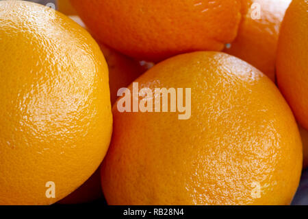 Closeup of several whole Navel oranges. - Stock Image