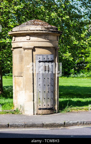 A limestone ashlar circular sentry box with worn plank door and strap hinge c1810 on the corner of Norfolk Crescent in the city of Bath Somerset. - Stock Image