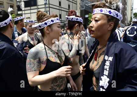 TOKYO, JAPAN - MAY 18: Heavily tattooed Japanese women walk in the street of Asakusa during 'Sanja Matsuri' on May 18, 2019 in Tokyo, Japan. A boisterous traditional mikoshi (portable shrine) is carried in the streets of Asakusa to bring goodluck, blessings and prosperity to the area and its inhabitants. (Photo: Richard Atrero de Guzman/ AFLO) - Stock Image