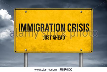 Immigration crisis - road sign warning - Stock Image