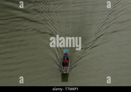 People traveling in the water of the Nam Ou river, Laos - Stock Image