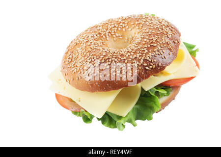 Fresh homemade bagel cheese, tomato and lettuce sandwich, isolated on white backgrond. Bagel with sesame seeds and sea salt. - Stock Image