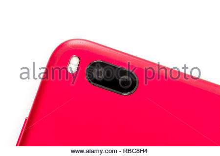red smartphone with dual camera lens technology isolated white background - Stock Image