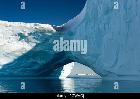 Antarctica, Weddell Sea, large Antarctic iceberg with natural arch through - Stock Image
