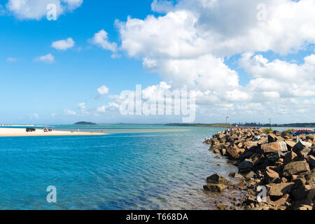 Crowdy Head, NSW, Australia-April 21, 2019: People enjoying the sunny weather in the small fishing village of Crowdy Head, famous for the breakwall us - Stock Image
