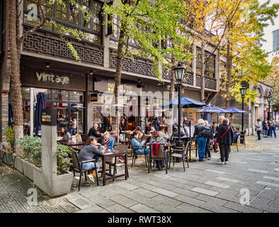 30 November 2018: Shanghai, China - Pavement cafe in the Xintiandi area of Shanghai, now an important shopping and leisure centre. - Stock Image