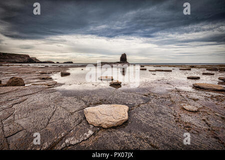 Black Nab, a rock pillar at Saltwick Bay, near Whitby, North Yorkshire. - Stock Image