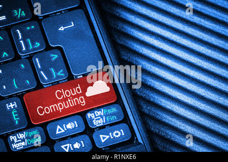 Close up of computer laptop keyboard with red button Cloud Computing concept and copy space. - Stock Image