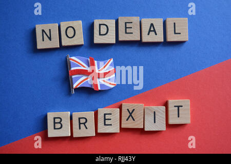 Creative Concept : British politics : 3d Union Jack flag and the words Brexit and No Deal  isolated on a blue and red background - Stock Image