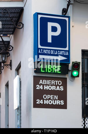Sign for a paid parking garage in Seville. The green light and Libre sign show that there is space available - Stock Image